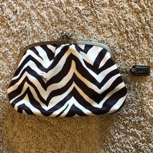 Coach satin zebra print wristlet clutch